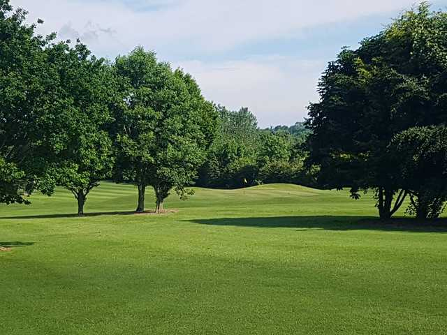A sunny day view of a hole at Pococke Golf Course.