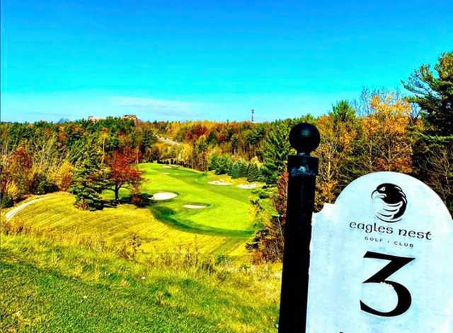 A view from tee #3 sign at Eagles Nest Golf Club.