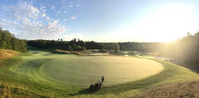 A sunny day view of a green at Eagles Nest Golf Club.