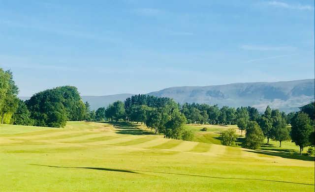 A sunny day view of a fairway at Kirkintilloch Golf Club.