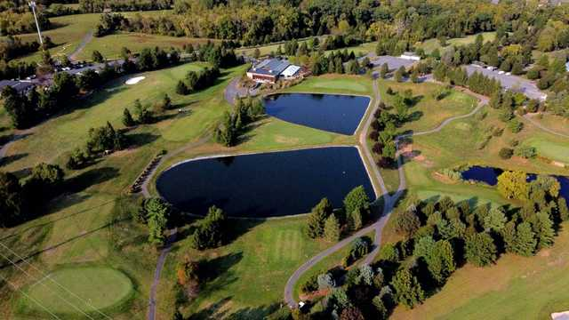 Aerial view of the 10th green on the left and the 18th near the clubhouse at Liberty Forge Golf Course.