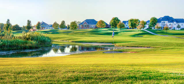A view of a green with bunkers and water coming into play at Hunters Ridge Golf Course.