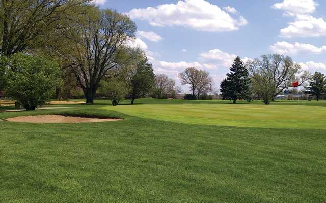 A sunny day view of a green at Sycamore Golf Club.
