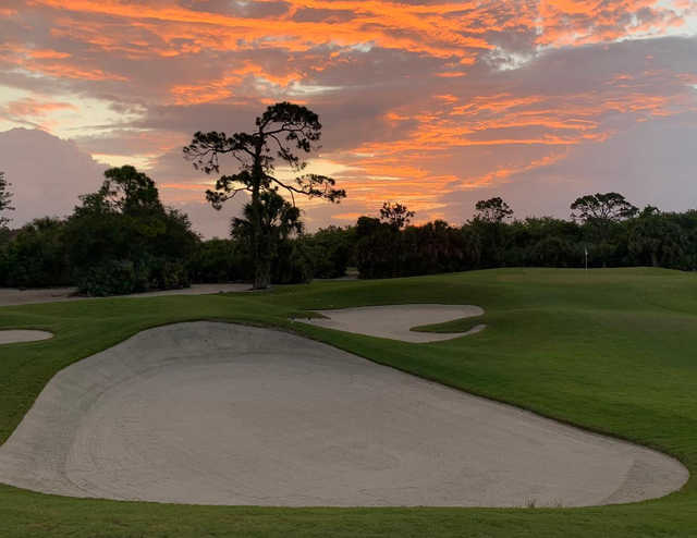 A sunset view of the 8th hole at Hawk's Nest from The Moorings Yacht & Country Club.