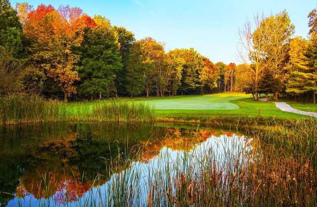 A fall day view of a fairway at NorthBrook Country Club.