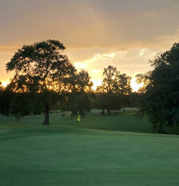 Sunset view of the 18th green at Yadkin Country Club.