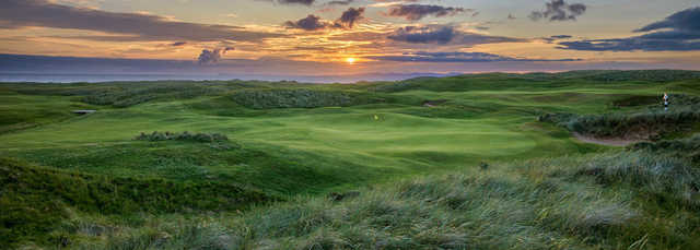 A sunset view of green #9 at Machrihanish Dunes Golf Club.