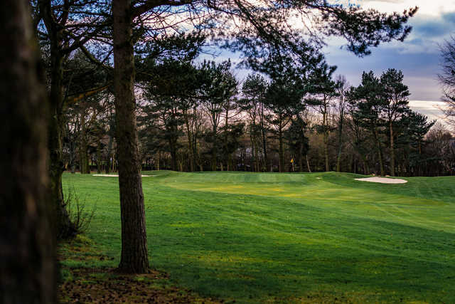 A view of a green flanked by bunkers at Westerhope Golf Club.