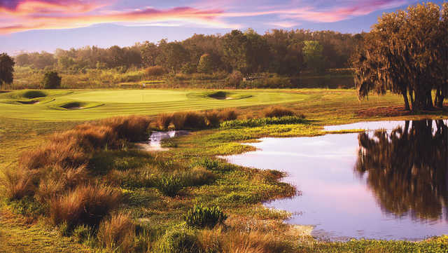 A sunset view of a green at International from ChampionsGate Golf Club.
