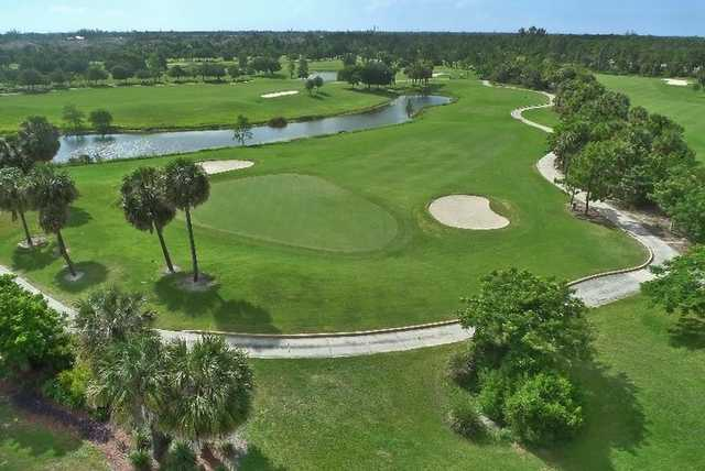 Aerial view of green #8 protected by bunkers at Osprey from Okeeheelee Golf Course