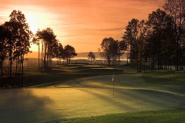 A dusk view of the 5th green at Blue Ridge Shadows Golf Club