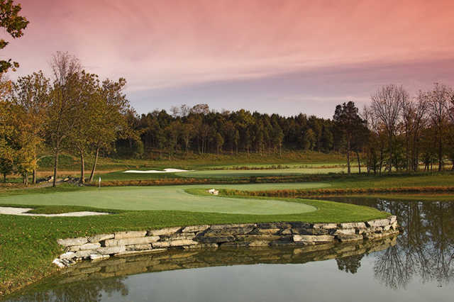 A view of green #14 surrounded by bunkers at Blue Ridge Shadows Golf Club
