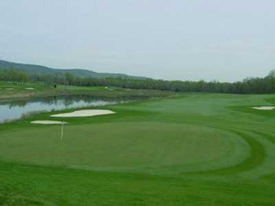 A view of green #9 with water coming into play from left at Bull Run Country Club