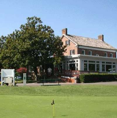 A view of the clubhouse and putting green at Pohick Bay Golf Course