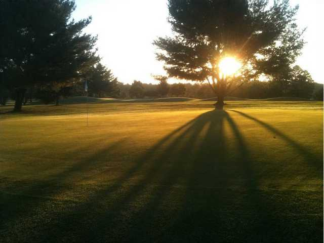 A sunny view of green at Hollows Golf Club