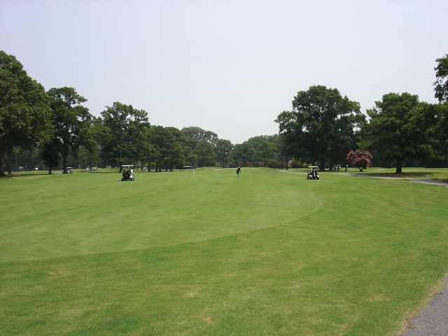 A view of fairway with narrow road on the right at Ocean View Golf Course.