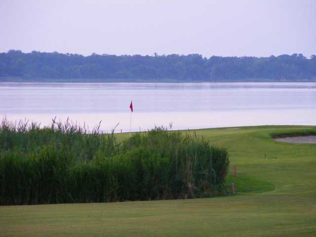 A view of the 18th green with water in background at Sleepy Hole Golf Course