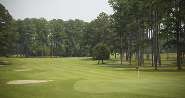 A view of fairway and green with bunkers on the left at Suffolk Golf Course