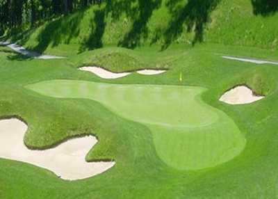 A view of a green protected by bunkers at Forest Greens Golf Club.