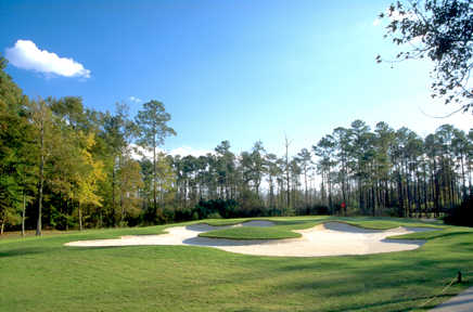 A view of hole #9 surrounded by bunkers at Hell's Point Golf Club