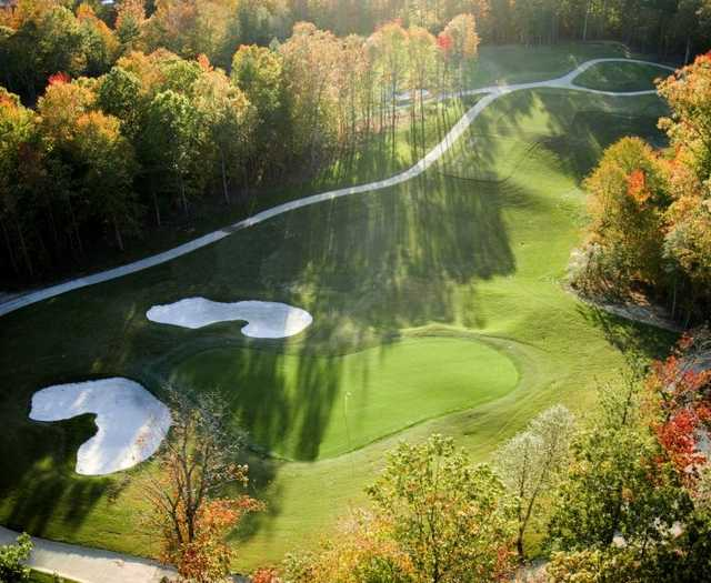 Aerial fall view of green protected by bunkers (courtesy of Williamsburg National Golf Club, Golf Shots Unlimited 2006)