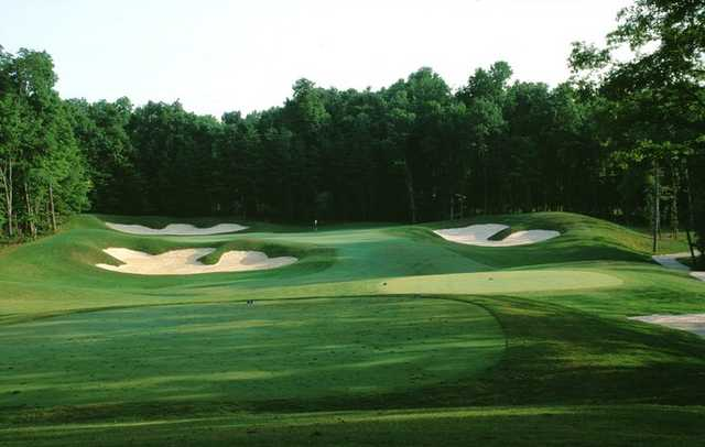 A view of green #13 protected by bunkers at Old Hickory Golf Club