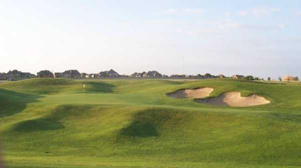 A view of the 5th green protected by bunkers at WestRidge Golf Course