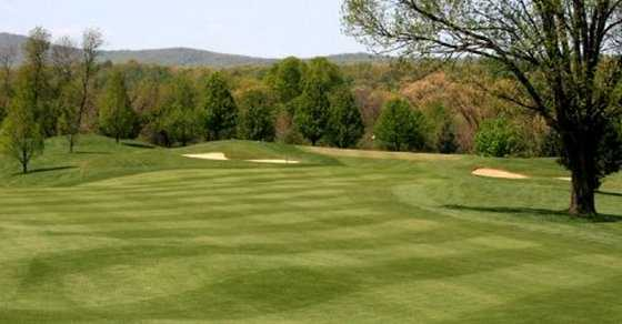 A view of a green protected by bunkers at Little Bennett Golf Course