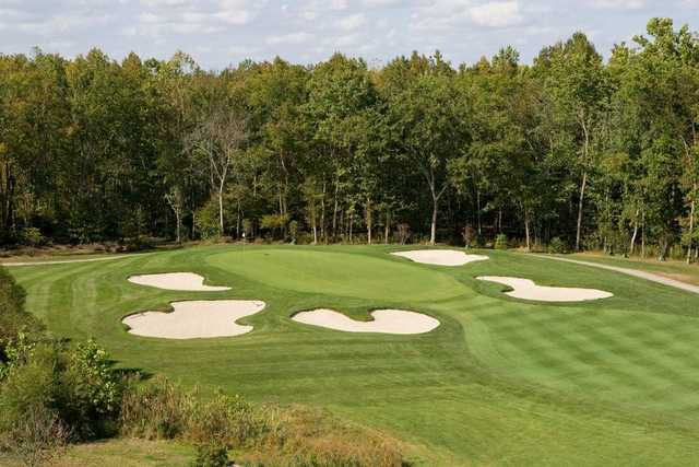 A view of green surrounded by bunkers at Renditions Golf Course