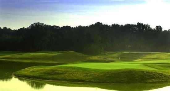 A view of green #3 surrounded by water at Compass Pointe Golf Club - East Course