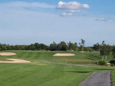 A view of the 12th green protected by bunkers at Cherry Creek Golf - The Links Course