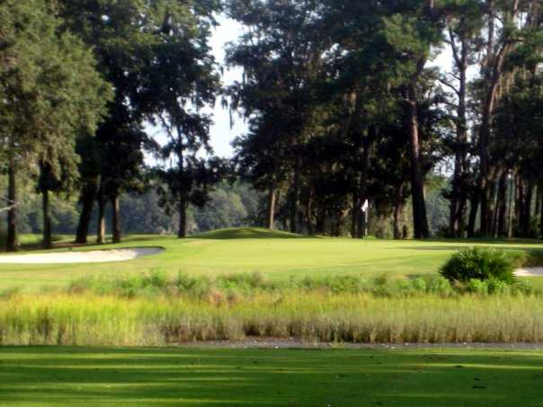 A view of green protected by bunkers at Sanctuary Golf Club