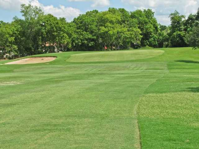 A view of green with bunker on the left at Bryan Golf Course