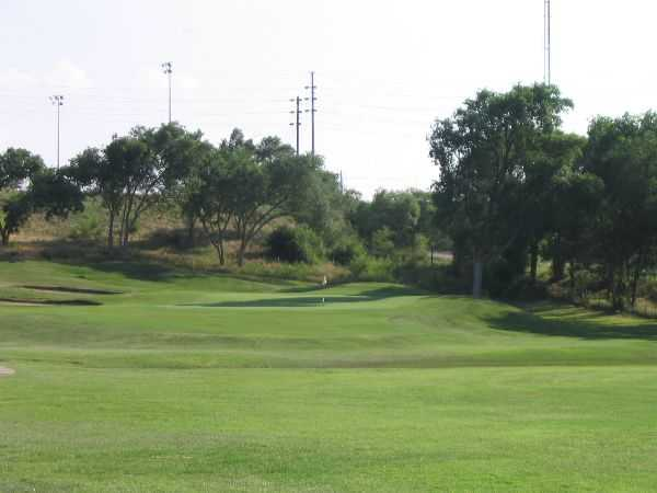 A view of a green with bunkers on the left at Canyon Course from Meadowbrook Golf Complex