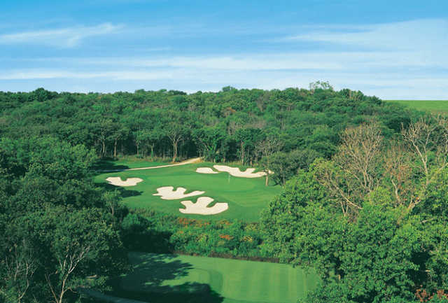 A view of green #17 surrounded by bunkers at Cowboys Golf Club