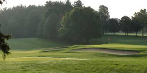 A view of green protected by bunkers at Greenfield Golf Course