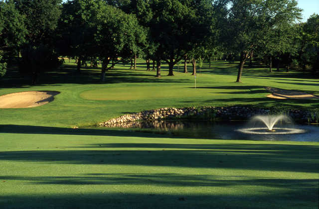 A view of a green protected by bunkers at Meadowbrook Country Club.