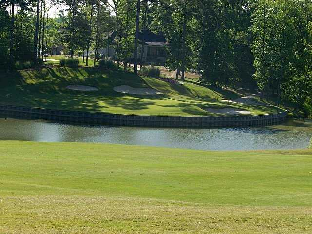 A view over the water of green #9 at Cypress Creekers' Golf Club