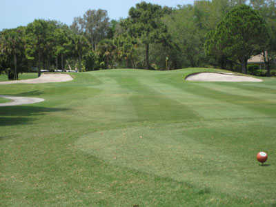 A view of the 5th green protected by bunkers at Boca Royale Golf & Country Club.