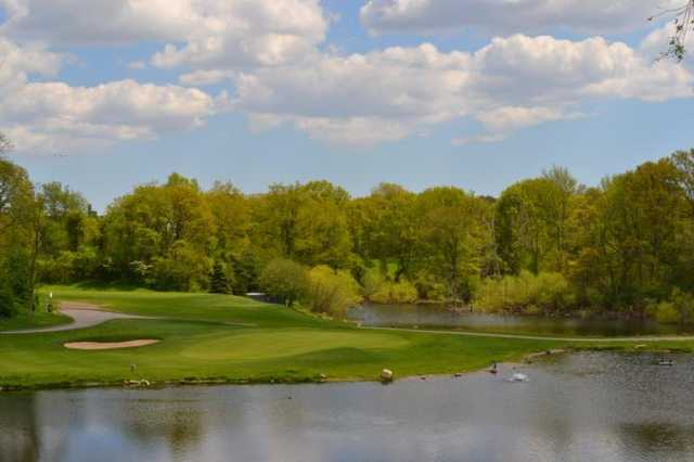 A view of a hole surrounded by water at Douglaston Golf Club