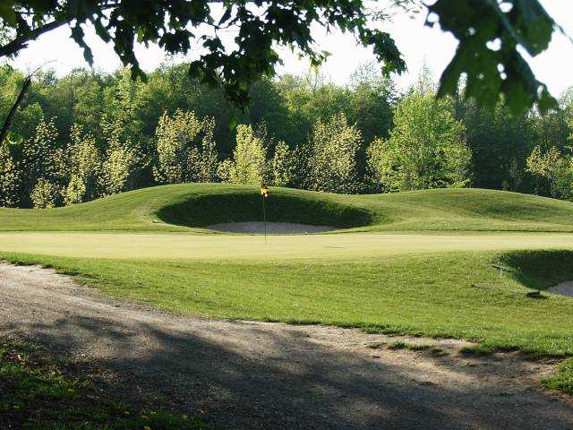 A view of a green protected by bunkers at Island Oaks at Lima Golf & Country Club