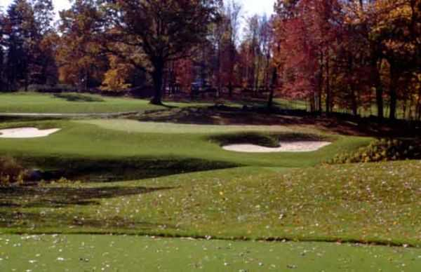 A view of hole #14 protected by bunkers at Hudson Hills Golf Course