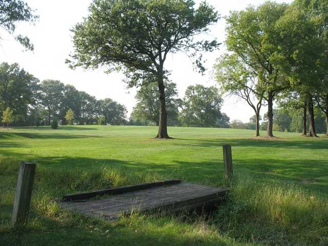 A view of fairway #16 with bridge in foreground at South Shore Golf Course