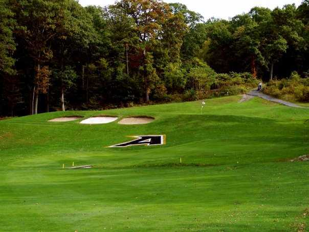 A view of green #1 protected by bunkers at West Point Golf Course