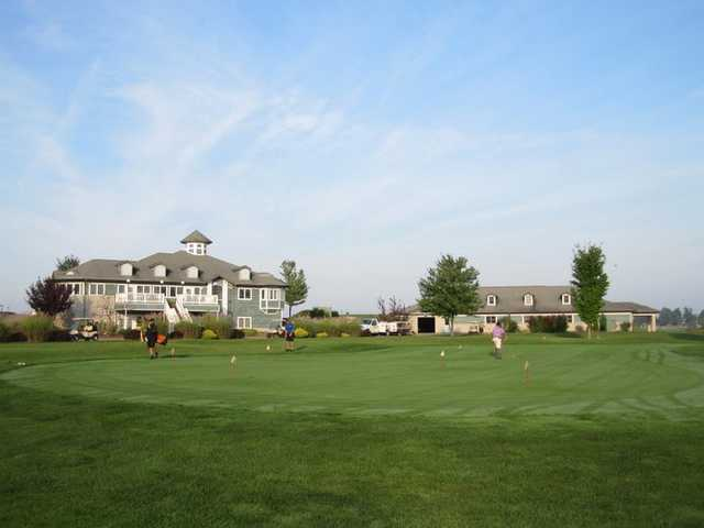 A view of the clubhouse and putting green at Orchards Golf Course
