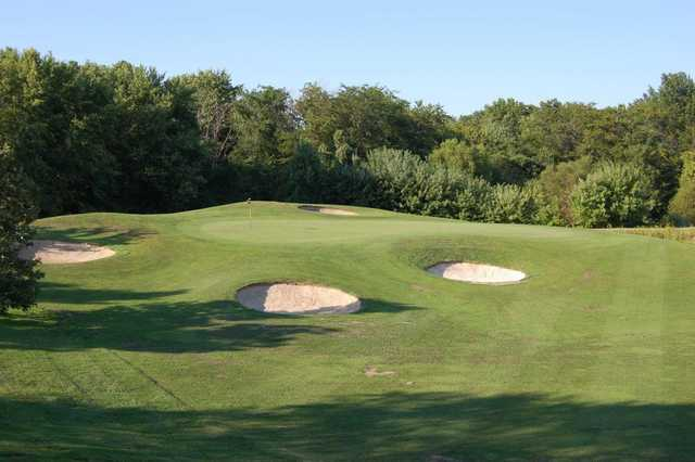 A view of a hole protected by bunkers at Championship Course from Governors Run Golf & Country Club
