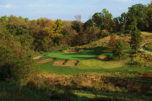 A view of green protected by bunkers at Far Oaks Golf Club