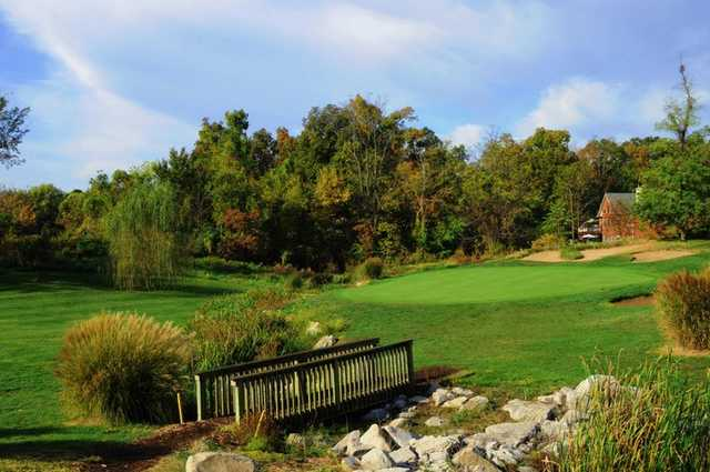 A view of a hole with bridge in foreground at Far Oaks Golf Club