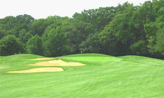 A view of a green with bunkers on the left at Indian Boundary Golf Course.