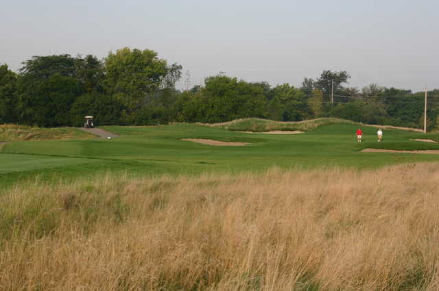 A view of green protected by bunkers at Red Tail Run Golf Club